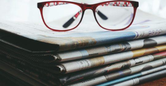 red-framed-eyeglasses-on-newspapers-3886870